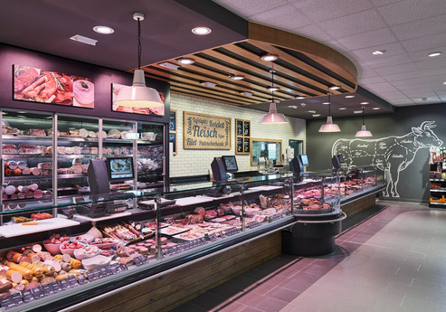 Meat counter with great colour scheme, visuals and ceiling design