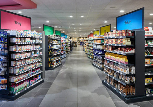 Colourful aisle signs help customers find their way at the Subey EDEKA